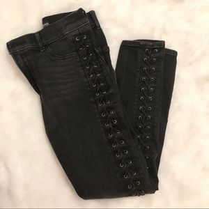 Lace up grommet jeans